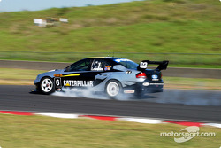 Round 2 winner and Ford hero Craig Lowndes locks a front break