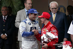 The podium: race winner Juan Pablo Montoya with Michael Schumacher