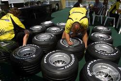Jordan team members prepare tires