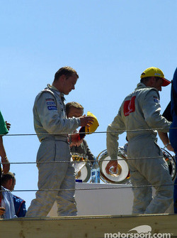 Marcel Fassler and Bernd Schneider on the podium