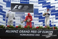 The podium: champagne for race winner Ralf Schumacher, Juan Pablo Montoya and Rubens Barrichello