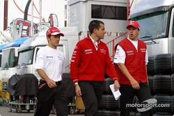 Cristiano da Matta, Ange Pasquali and Olivier Panis leave the track