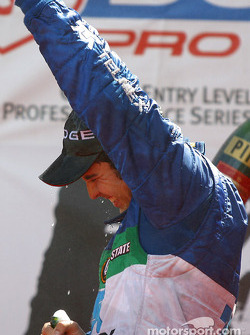 The podium: champagne for Memo Rojas