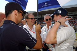 Dr Helmut Panke (Chairman of the board BMW Group) and Dr Burkard Goeschel (Board member for Developmet BMW Group) on the grid with Ralf Schumacher