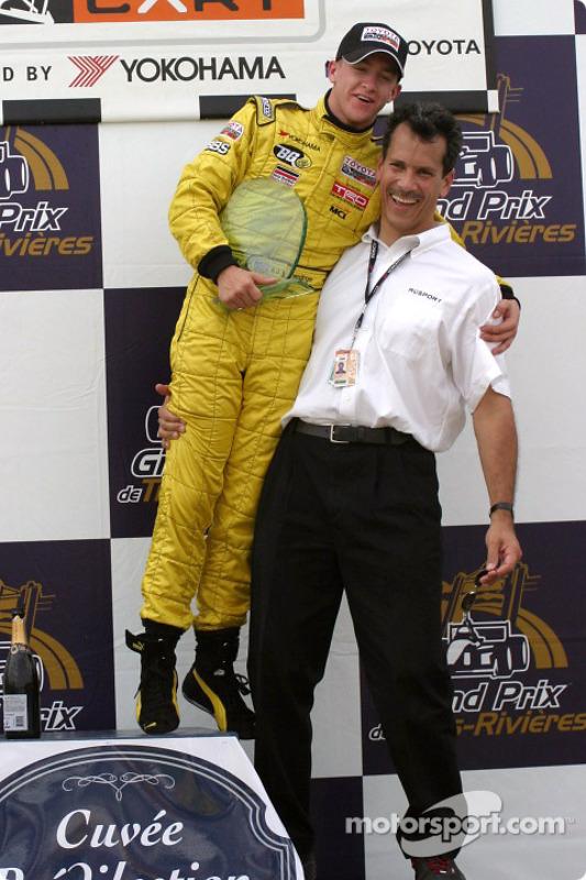 A.J. Allmendinger avec son chef d'équipe Carl Russo