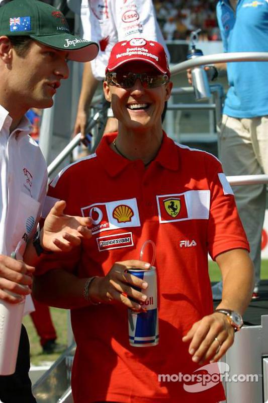 Mark Webber y Michael Schumacher