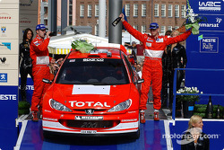 The podium: Richard Burns and co-driver Robert Reid celebrate third place finish