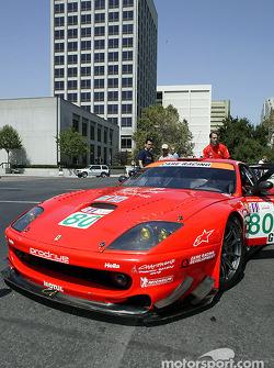 The Prodrive Ferrari navigates the narrow path to a parking spot
