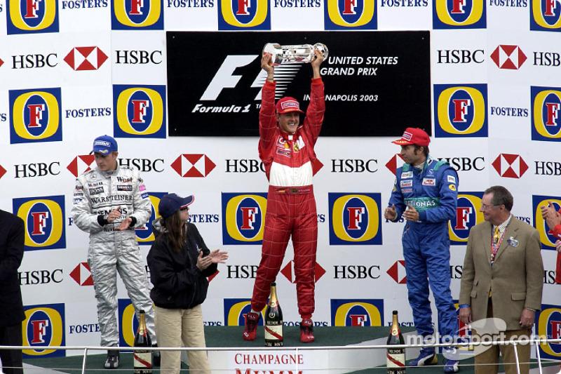 Podio: ganador de la carrera Michael Schumacher, segundo lugar Kimi Raikkonen y tercer lugar Heinz-Harald Frentzen