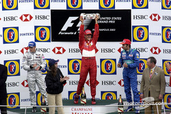 Podium: race winner Michael Schumacher with Kimi Raikkonen and Heinz-Harald Frentzen