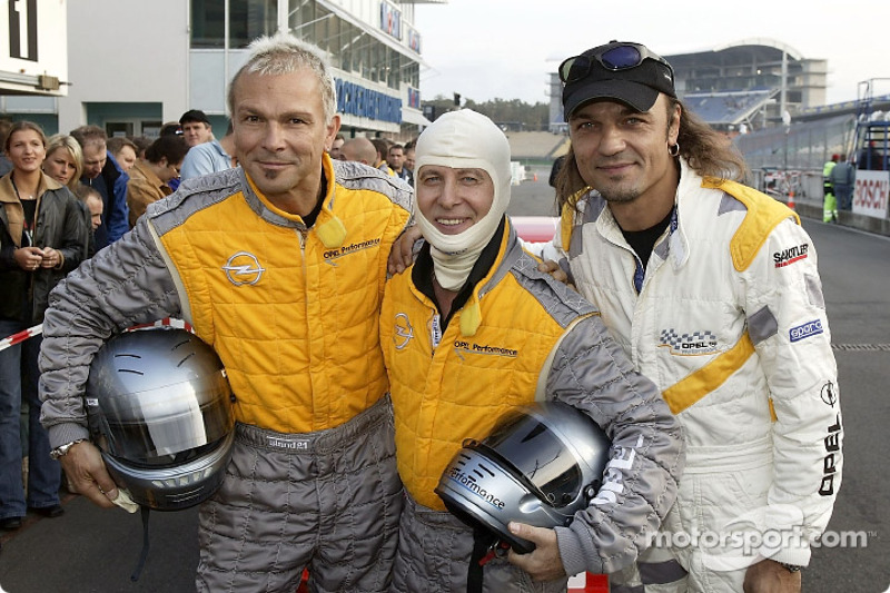 Rudolf Schenker, Klaus Meine and Matthias Jabs from the Scorpions prior to a ride in the racing ...