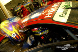 Greg Murphy briefs Jason Bright as he takes the wheel of the 05 car