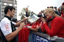 Mark Webber signs autographs