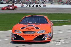 Robby Gordon pulls in as Dale Earnhardt Jr. streaks by