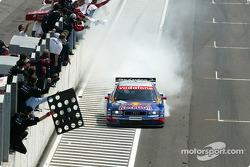 Race winner Mattias Ekström smokes the tires