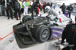 Allan McNish arrives at his pit with the damaged Audi R8