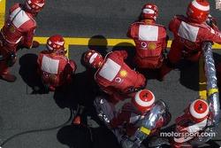 Ferrari team members wait for Rubens Barrichello