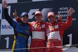 Podium: race winner Michael Schumacher with Fernando Alonso and Rubens Barrichello