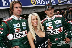 Emma B., Bjorn Wirdheim and Christian Klien in front of the Jaguar R5 to promote the new PlayStation 2 game Formula One 04