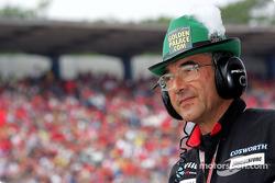 Minardi team member wears a German hat