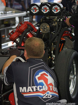 Crew works on Whit Bazemore's funny car