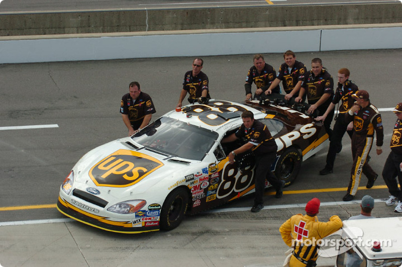 Dale Jarrett crew push the car back to the garage
