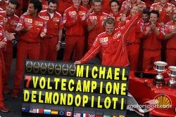Michael Schumacher celebrates 7th World Championship with Ferrari team members