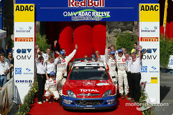 Podium: winners Sébastien Loeb and Daniel Elena celebrate with Carlos Sainz and Marc Marti