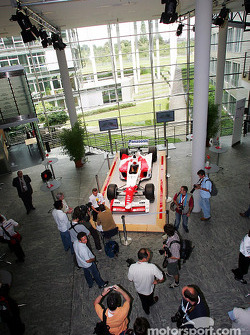 Olivier Panis being interviewed in front of a Toyota F1 replica car