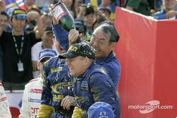 Podium: President of Fuji Heavy Industry Mr. Takenaka shares the joy of victory in the first ever WRC Rally Japan with Petter Solberg and Phil Mills