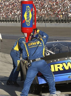 #97 Kurt Busch's team gives the IRWIN Ford four tires and gas