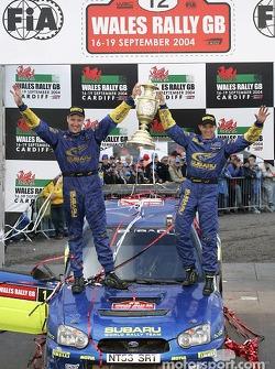 Podium: rally winners Petter Solberg and Phil Mills celebrate