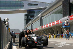 McLaren team members go to technical inspection