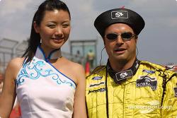 A Jordan team member with a grid girl