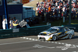 Craig Lowndes crosses the line after the shoot out