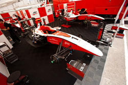 The cars of Alexander Rossi, Esteban Gutierrez, and Pedro Nunes, in the garage