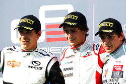 Esteban Gutierrez celebrates victory on the podium with Robert Wickens and Roberto Merhi