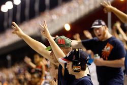 Fans hold up three fingers celebrating the win of Dale Earnhardt Jr.
