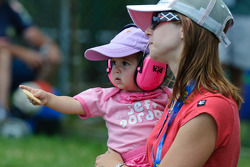 A young race fan watches on