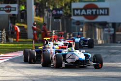 Felipe Guimaraes leads Dean Smith