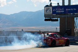 #30 Racers Edge Motorsports Mazda RX-8: Jade Buford, Andy Lally smokes on pitlane
