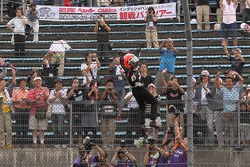 Race winner Helio Castroneves, Team Penske celebrates Spiderman style