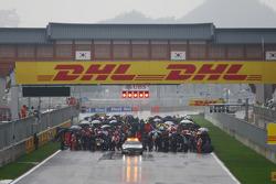 The cars await the race on the grid