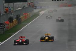 Timo Glock, Virgin Racing leads Robert Kubica, Renault F1 Team