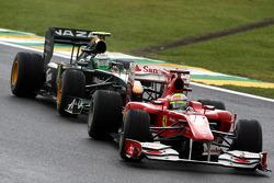 Felipe Massa, Scuderia Ferrari leads Heikki Kovalainen, Lotus F1 Team