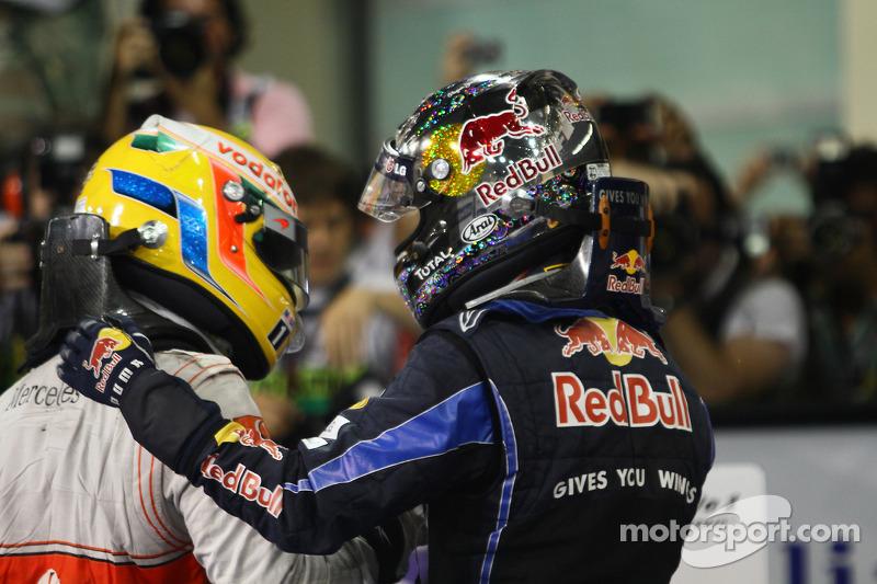 Race winner and 2010 Formula One World Champion Sebastian Vettel, Red Bull Racing, celebrates with Lewis Hamilton, McLaren Mercedes