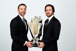 Five-time champion Jimmie Johnson poses with crew chief Chad Knaus and the Sprint Cup trophy