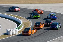 #171 APR Motorsport Volkswagen GTI: Ian Baas, Ryan Ellis leads a group of cars