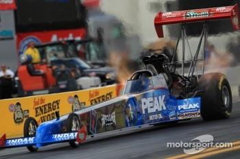 T. J. Zizzo during his burnout in his Peak Motor Oil / Herculiner Top Fuel Dragster