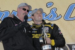 Morgan Lucas celebrates on stage in the winners circle after winning the Top Fuel category at the Kragen Oreilly Auto Parts NHRA Winternationals